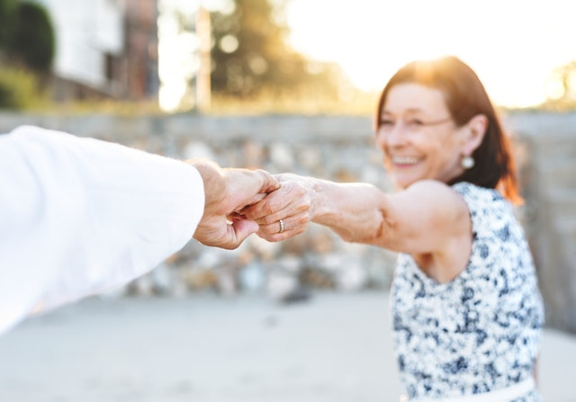woman holding hands with man