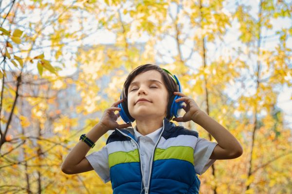 boy wearing blue headphones