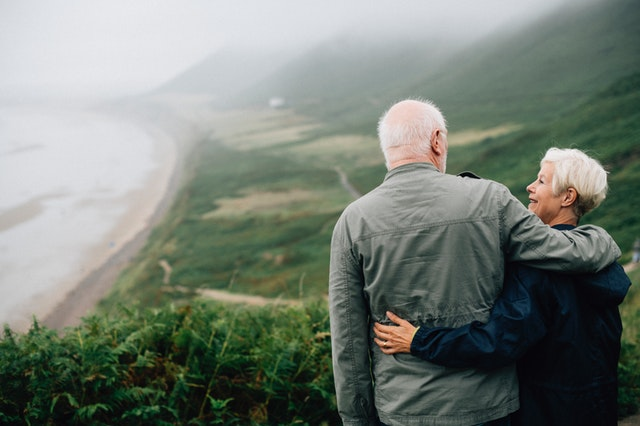 couple embracing each other overlooking scenic view