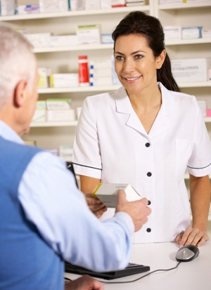 Pharmacist with elderly man