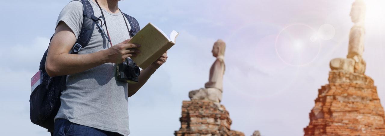 tourist reading a book