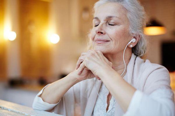 woman-listening-ear-buds